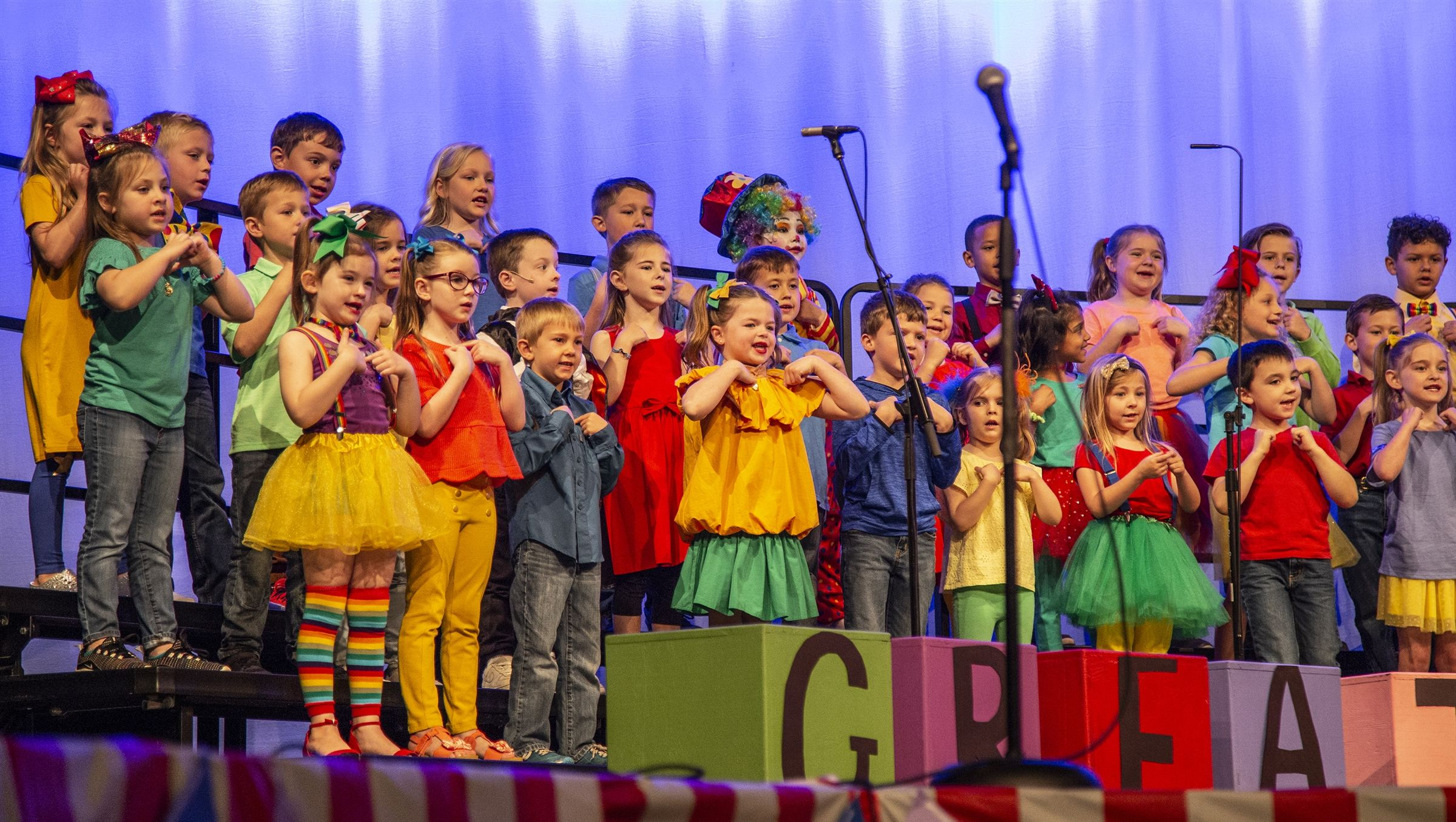 Preschool and Lower School students perform on stage for grandparents on Grandparents Day