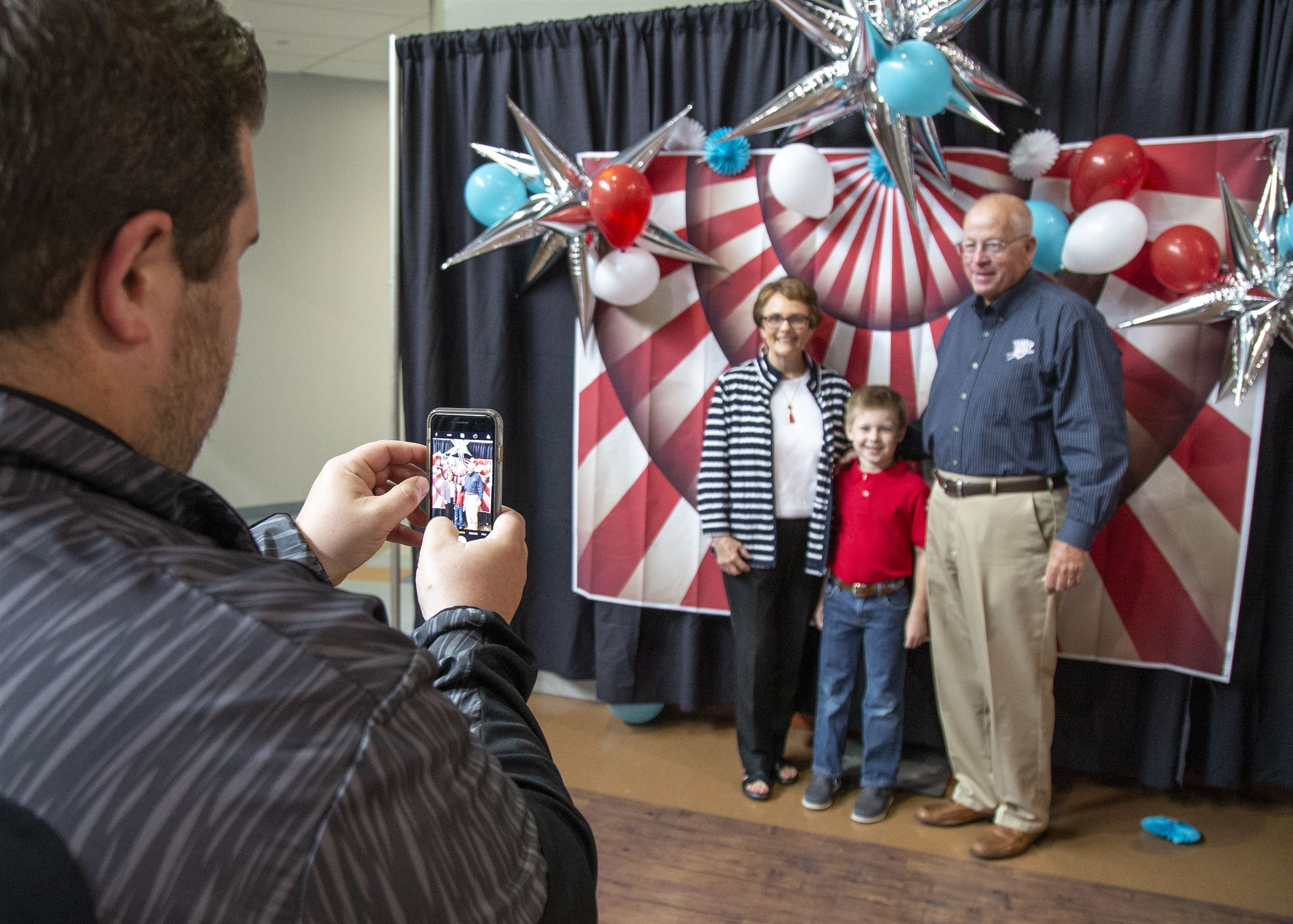 """Say ""Cheese!"" Grandparents and grandchildren enjoy the Grandparents Day Photo Booth"