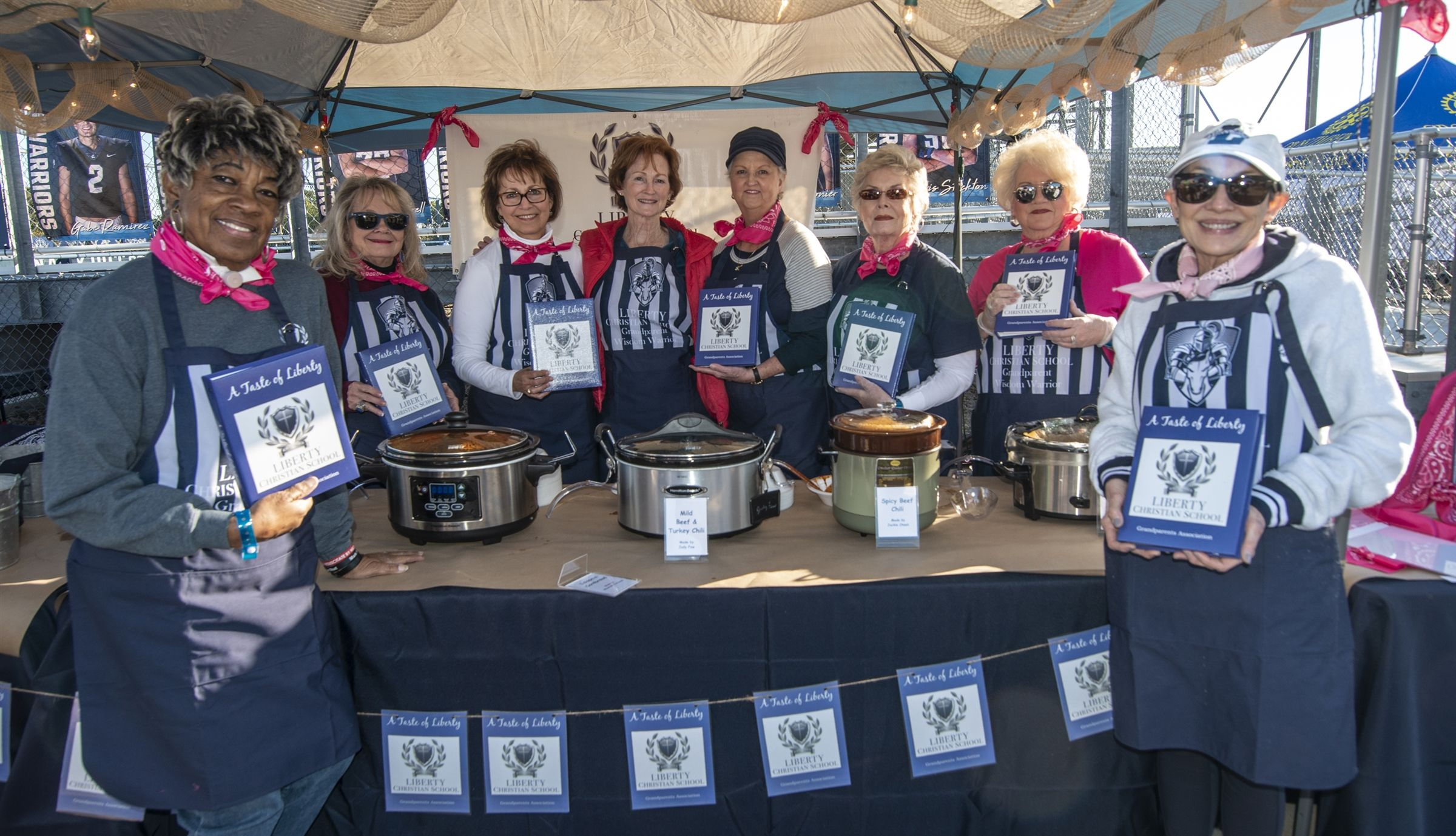 Grandparents display their cookbook at their Chili Cook-off booth