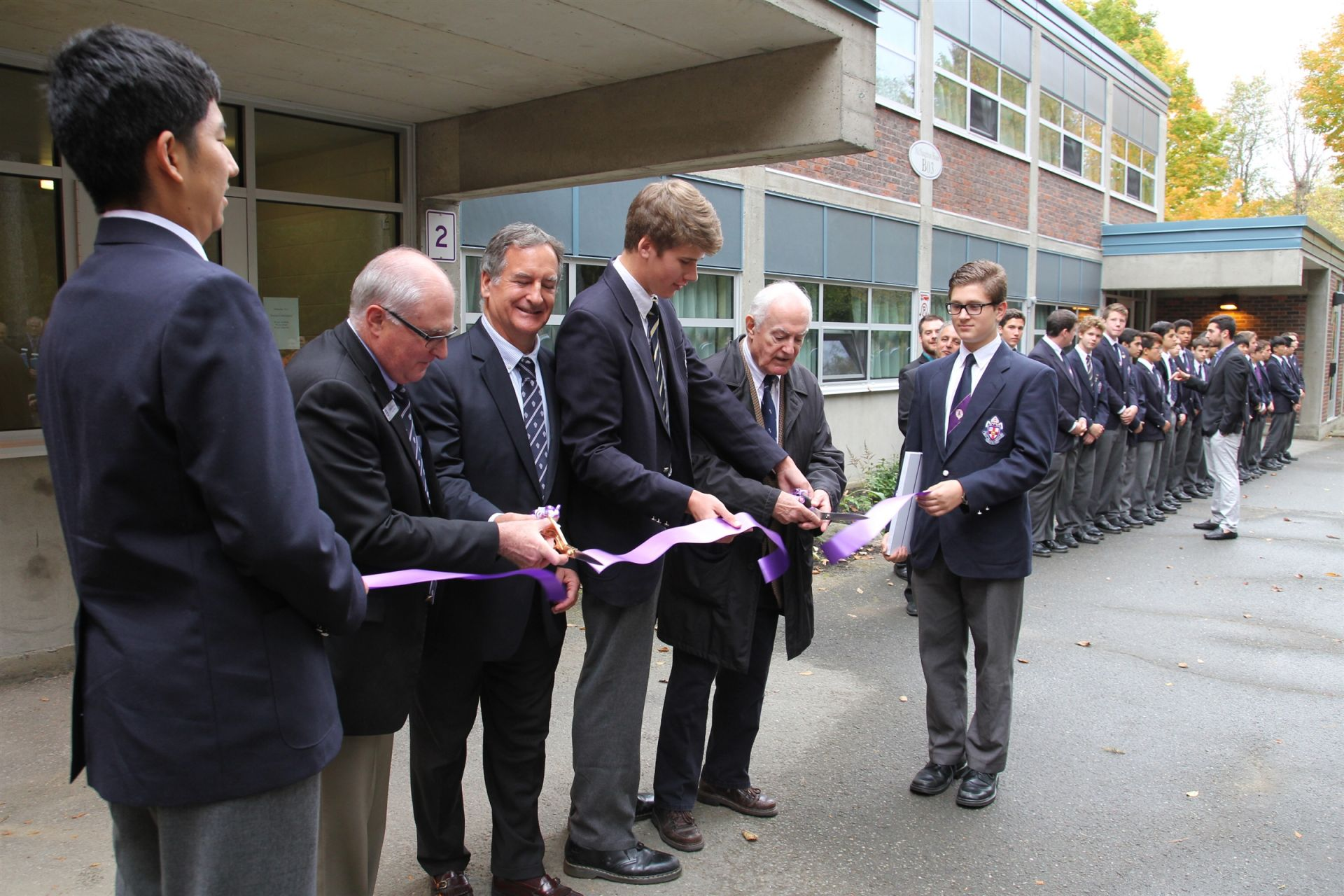 The ceremonial re-opening of McNaughton House after a complete renovation was completed in 2014. Cutting the ribbon at Head of School William Mitchell (BCS'63), Chair of the Board Tim Price (BCS'75), Head of House Brendan Barritt (BCS'15), and donor Scotty Fraser (BCS'46)