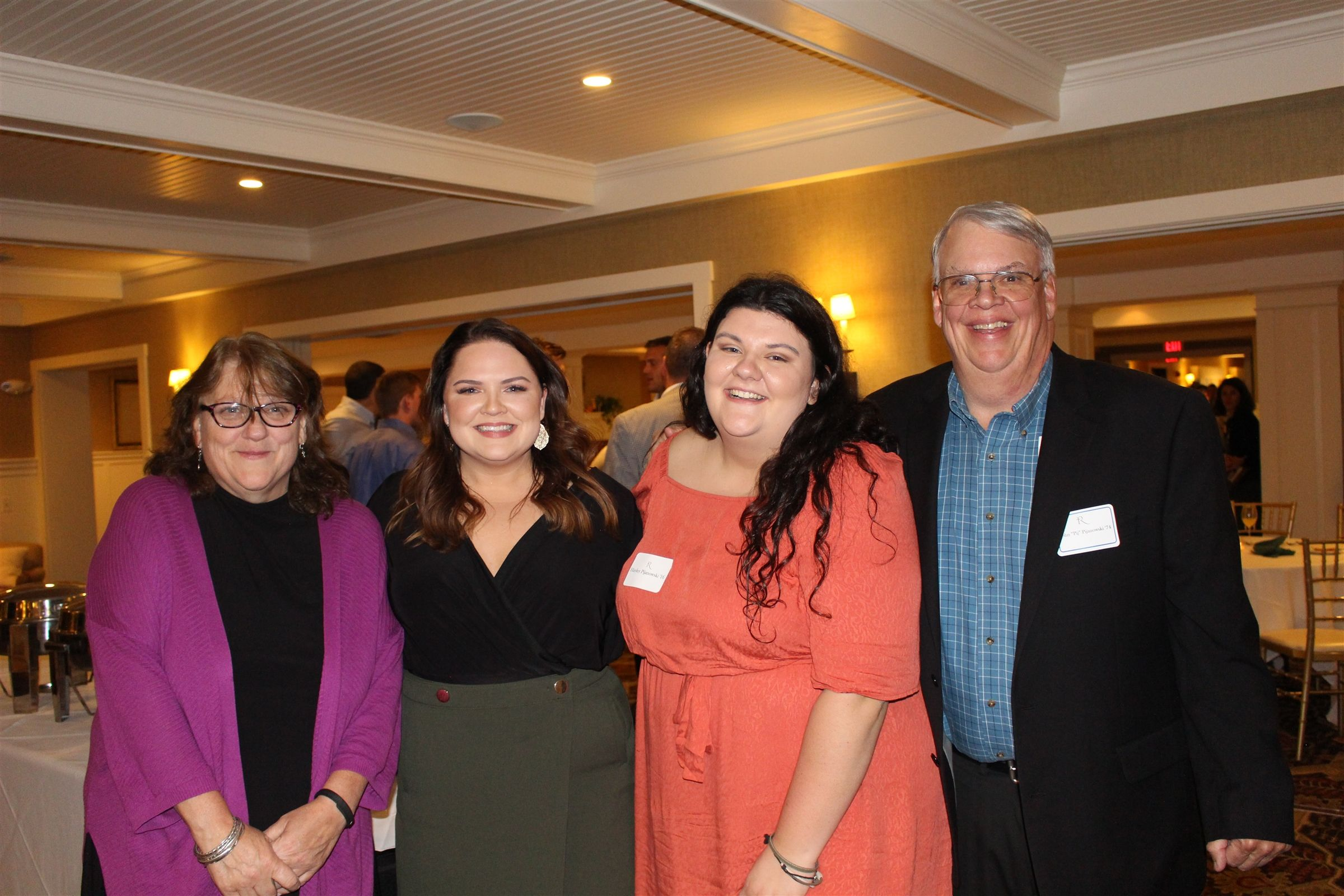 Inductees John '74 and Sheila Riley '82 Pijanowski with their daughters Emily '09 and Hayley '16