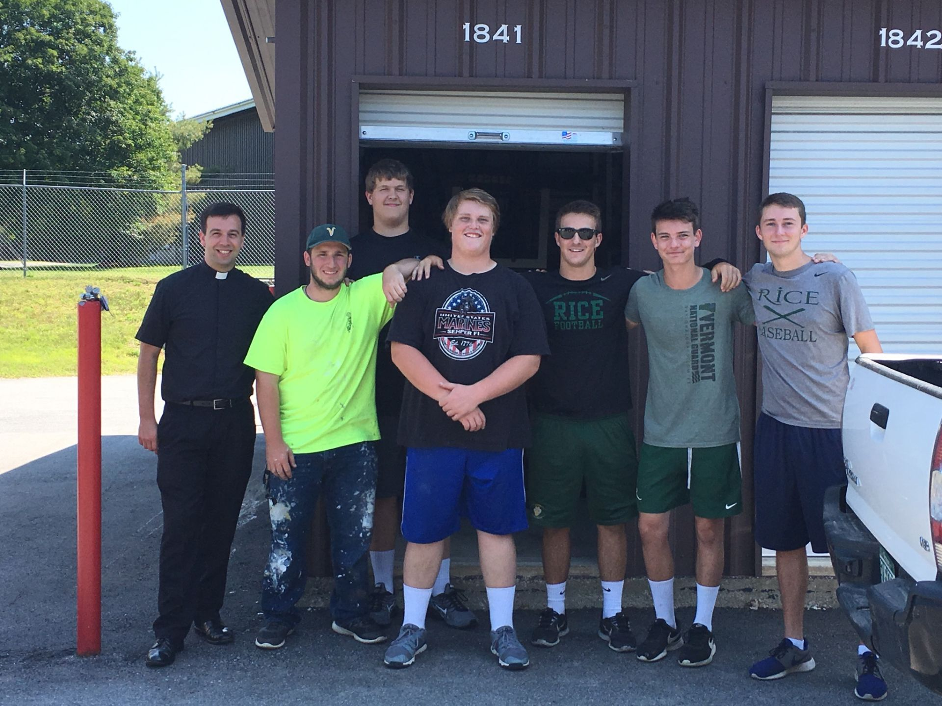 Members of the football team volunteered to help move a young community member out of her apartment