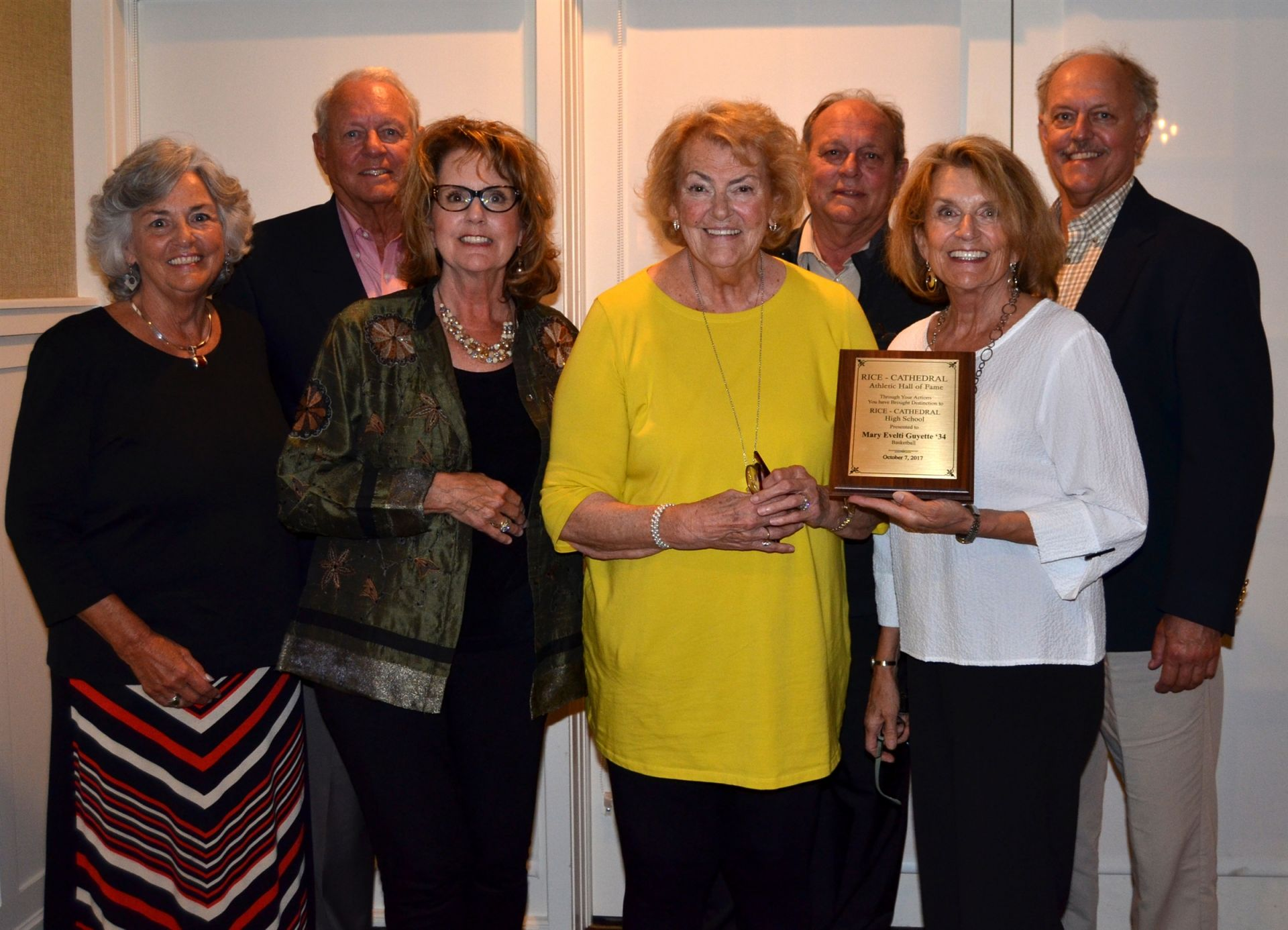 Mary Evelti Guyette's 7 children accepted her induction award on the family's behalf.
