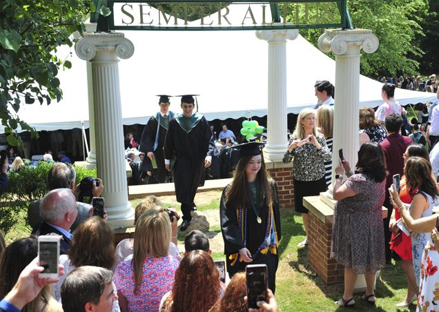 All graduates walk under the arches after receiving their diplomas.