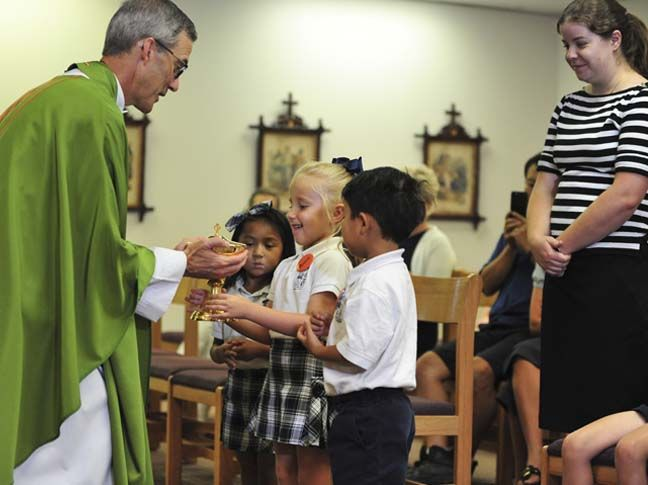 Students celebrate Mass weekly