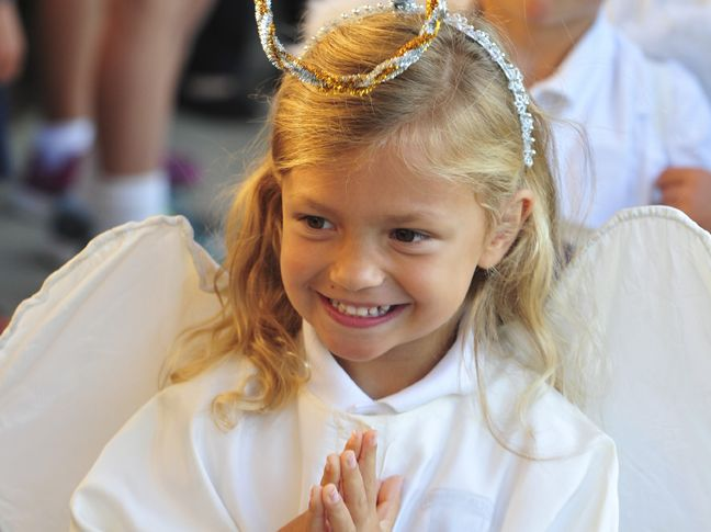 Pinecrest celebrates the Feast of the Holy Angels each year with our precious Angel Parade.