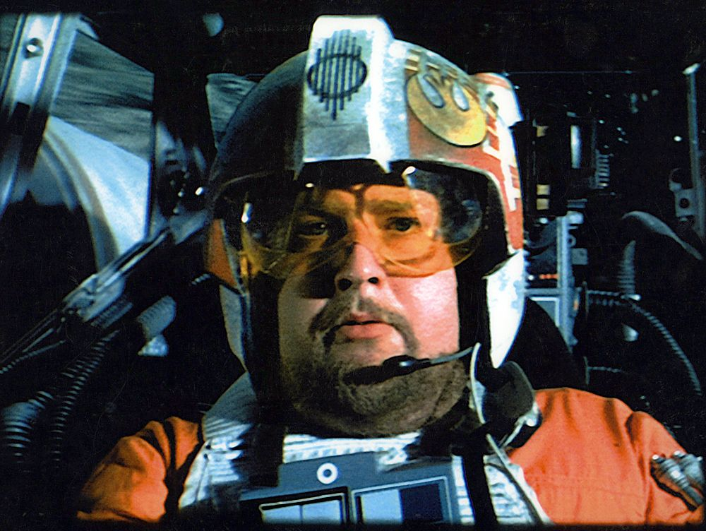 as the X-Wing fighter pilot 'Porkins' in the 1977 film Star Wars.