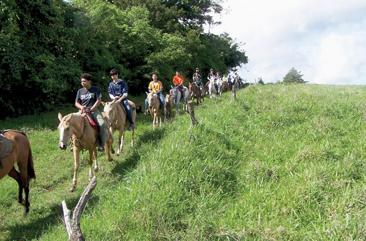 Students ride through the Costa Rica countryside.