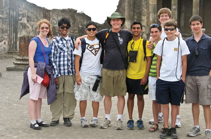 St. Mark's Latin teachers touring the ruins of Ancient Rome with students.