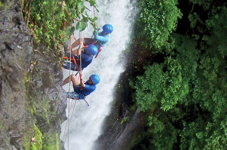 Students rapelling off of a waterfall in Costa Rica.