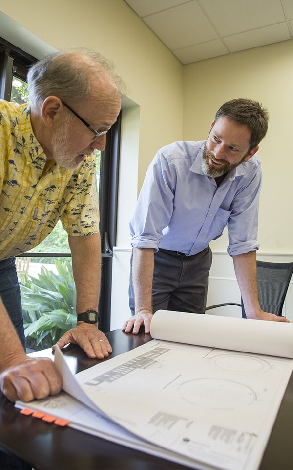 Doug Rummel and Fletcher Carron examine schematics for the Winn Science Center