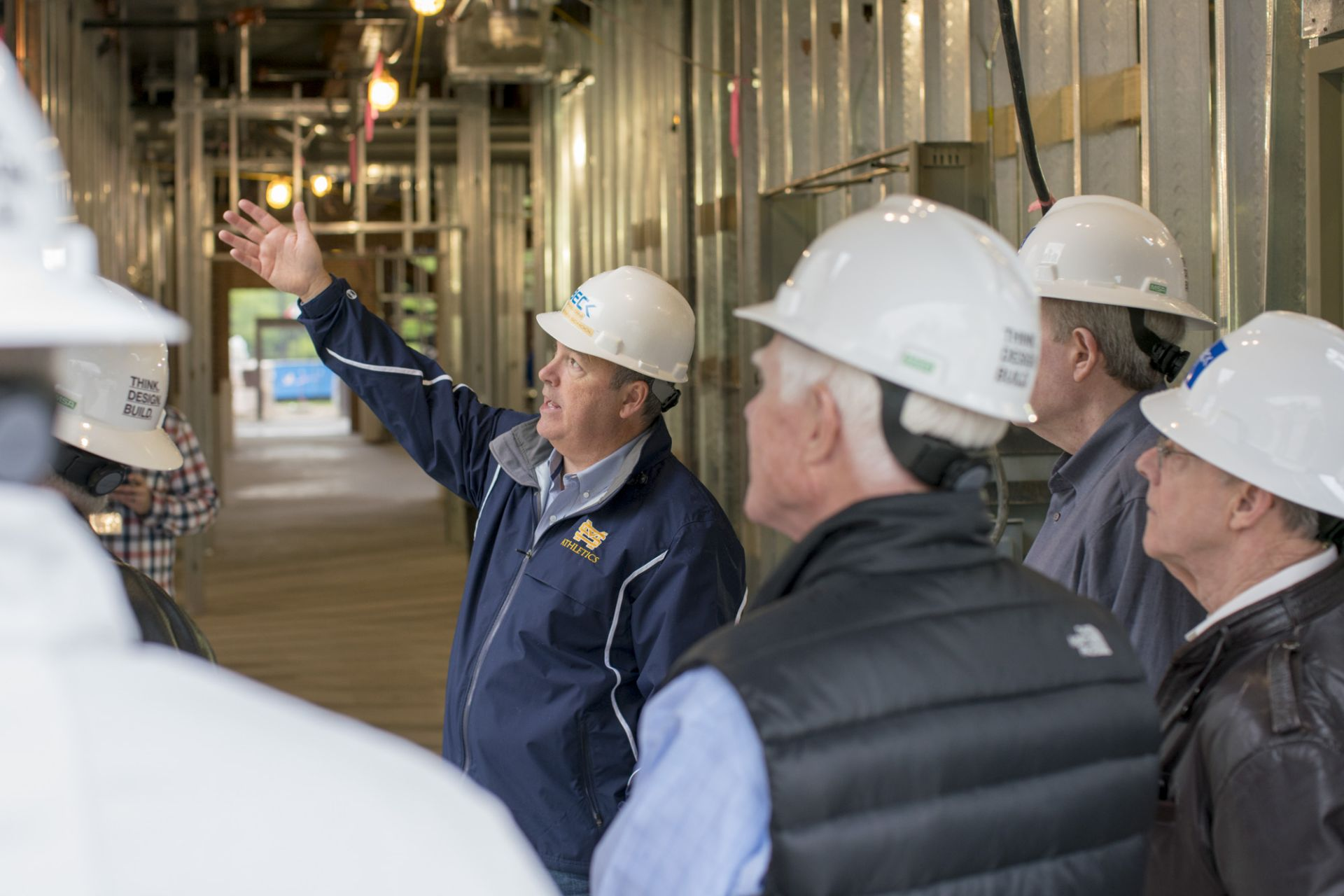 Eugene McDermott Headmaster David Dini leads a hard-hat tour of the Winn Science Center.