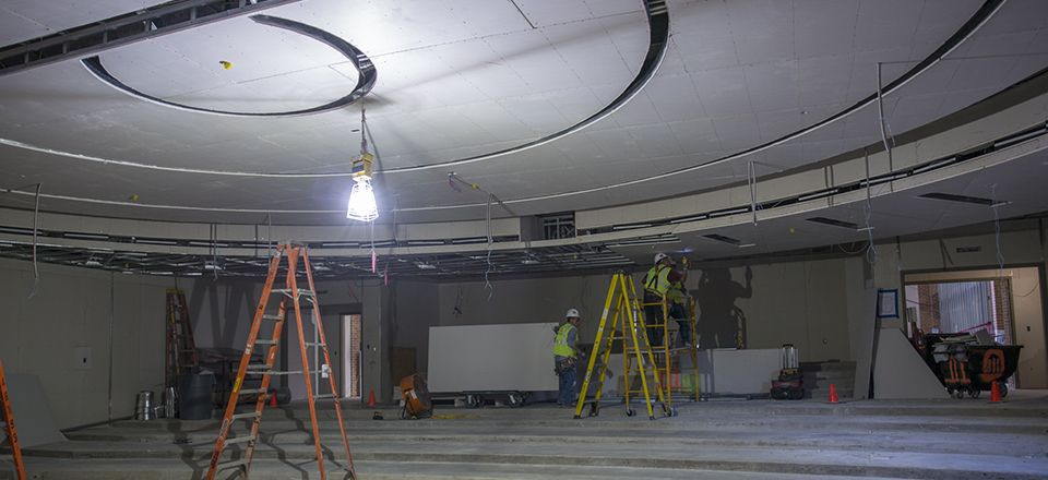 Installation of the Science Lecture Hall's sheetrock nears completion.