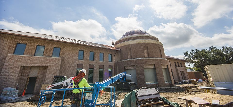 Crews finish installing the copper roof and dome panels.