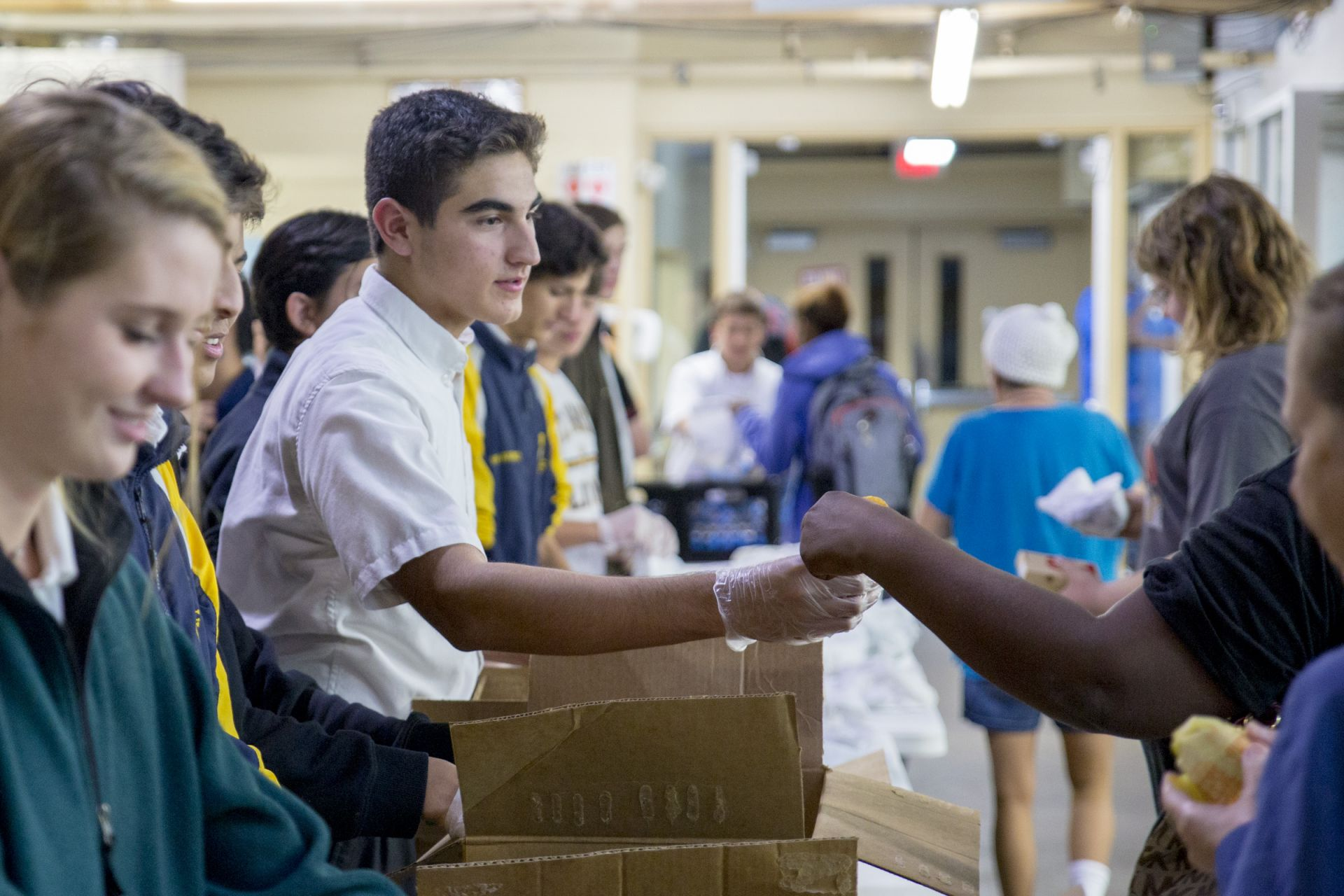 St. Mark's and Hockaday students hand out meals at Austin Street Center.