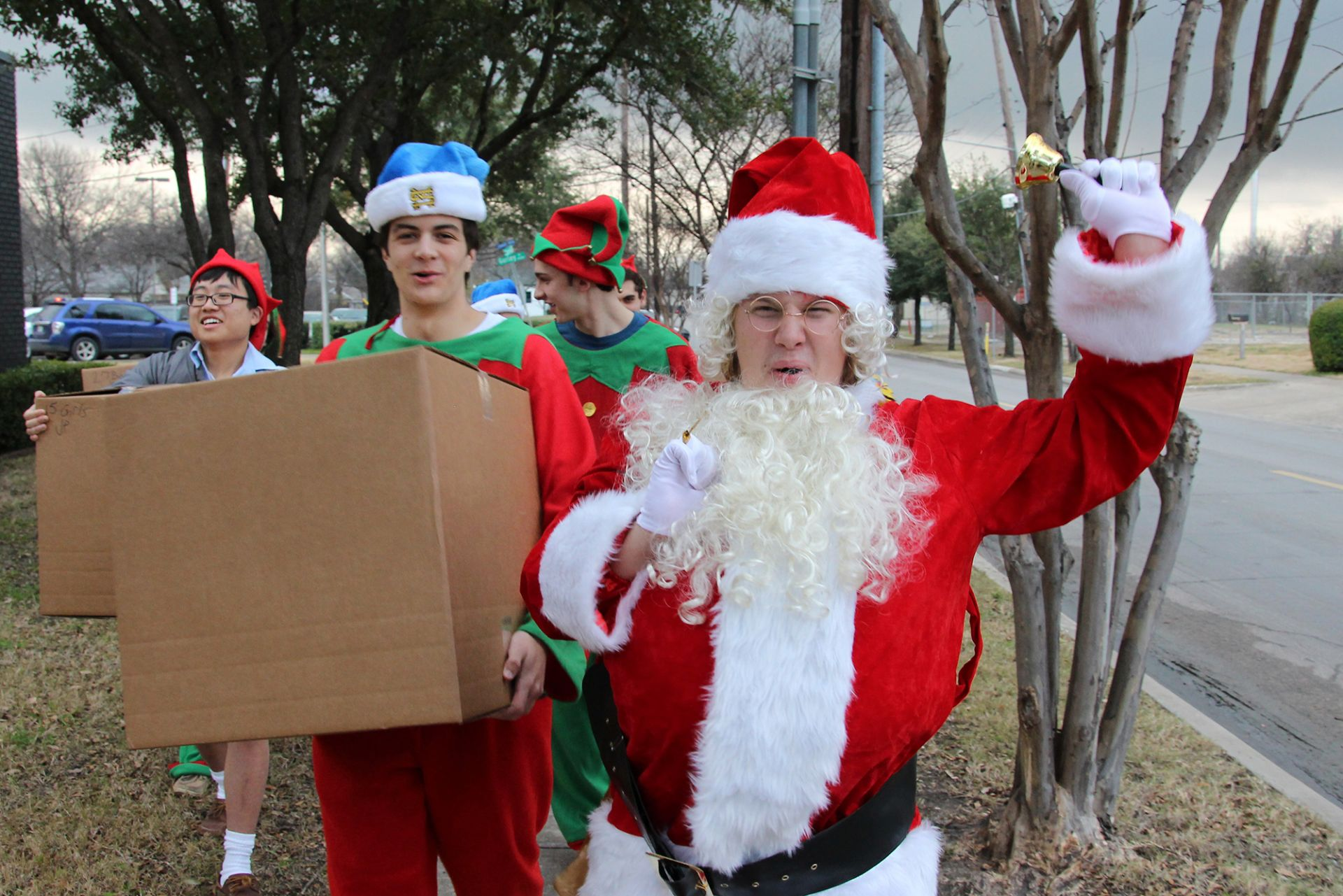 Santa and his elves deliver presents to David's Place in Dallas.