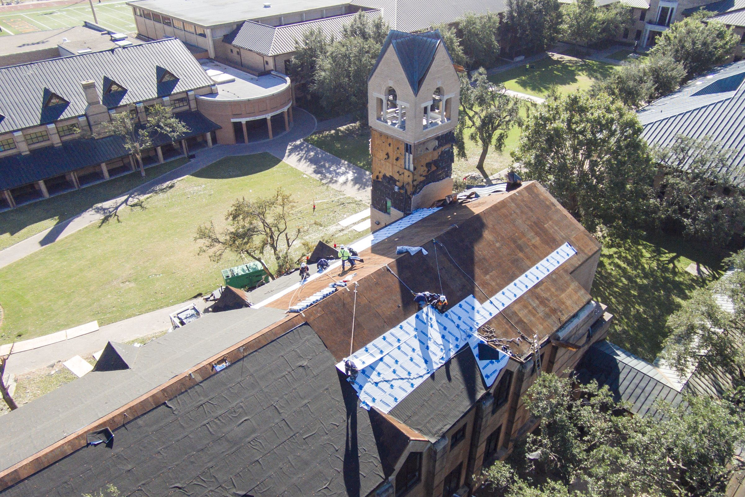 Crews begin repairing the Chapel roof and bell tower.