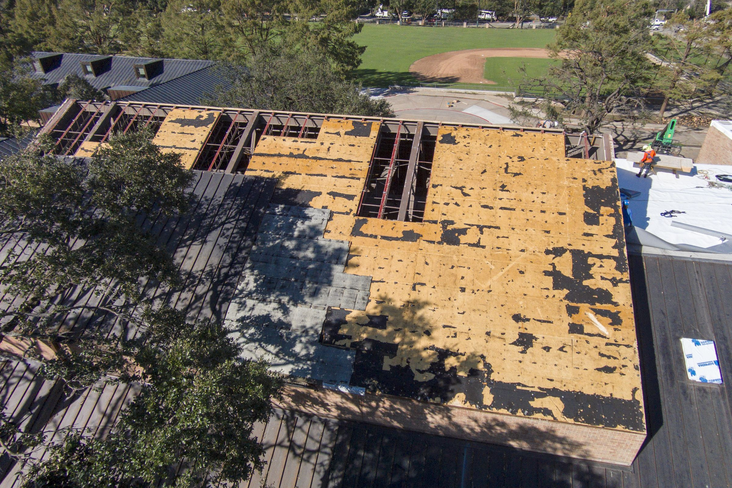 Crews patch up the roof of Decherd Auditorium.