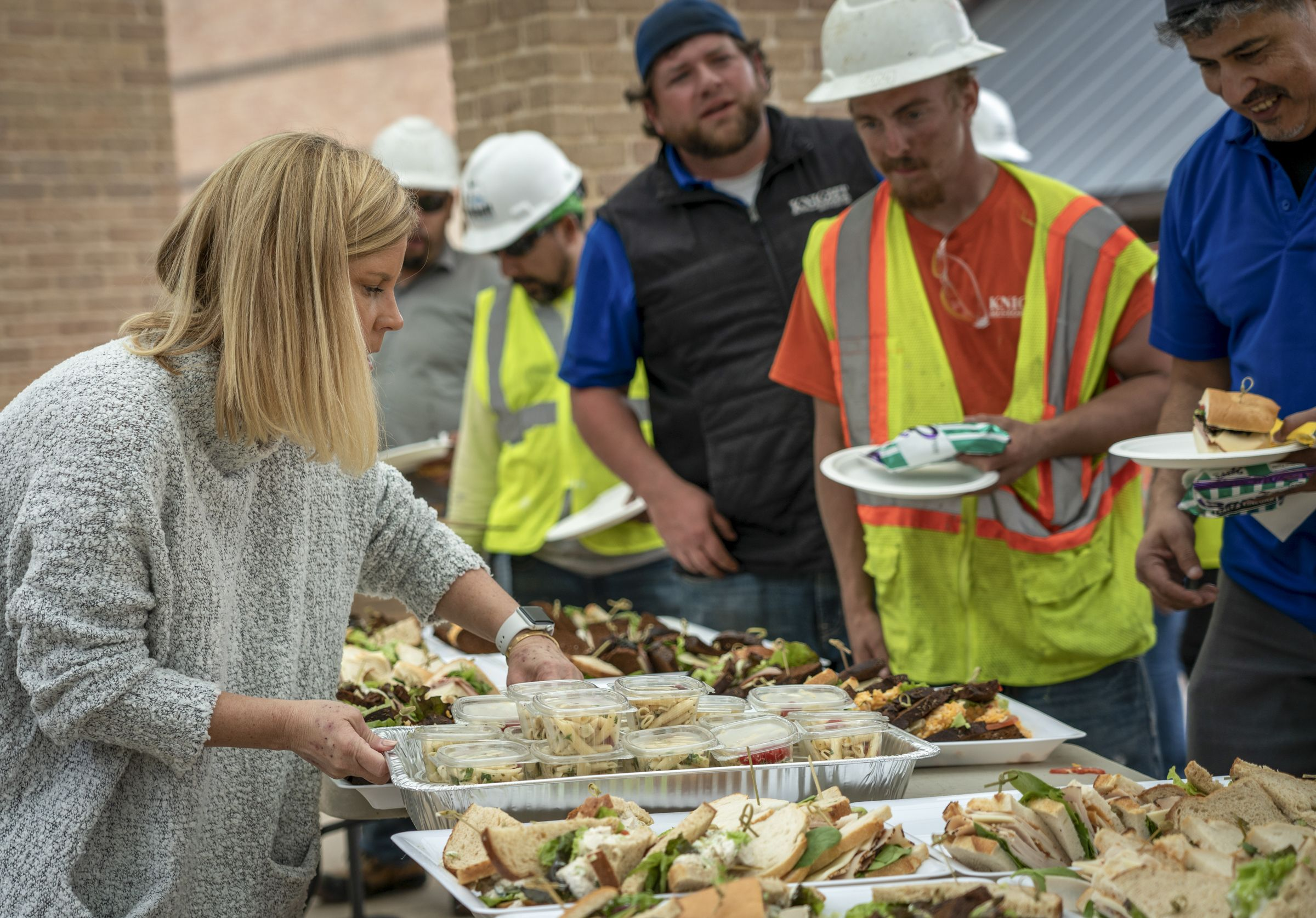 Nancy Dini leads volunteers in providing lunch to the campus workers.