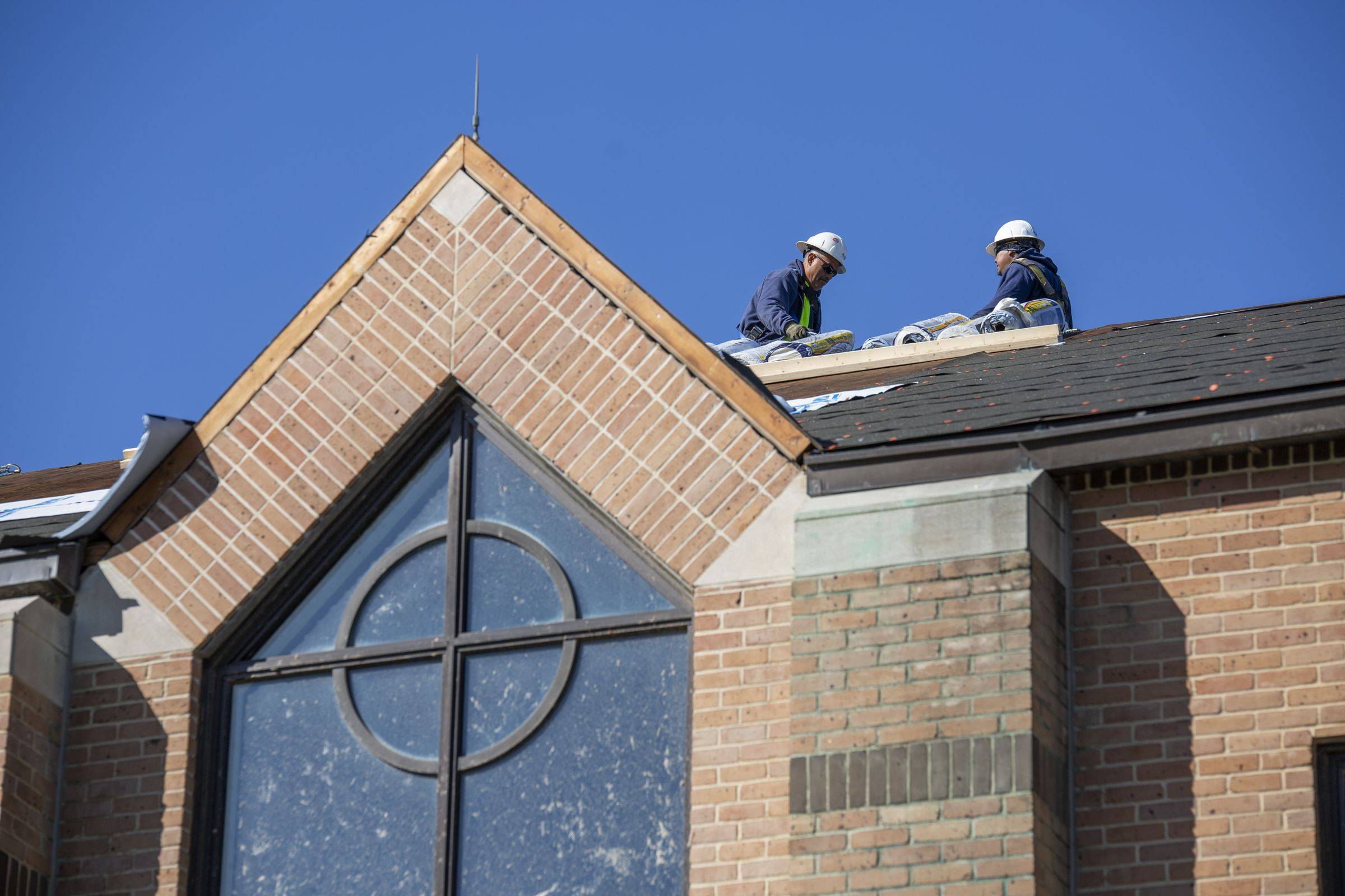 Workers repair the Chapel roof.