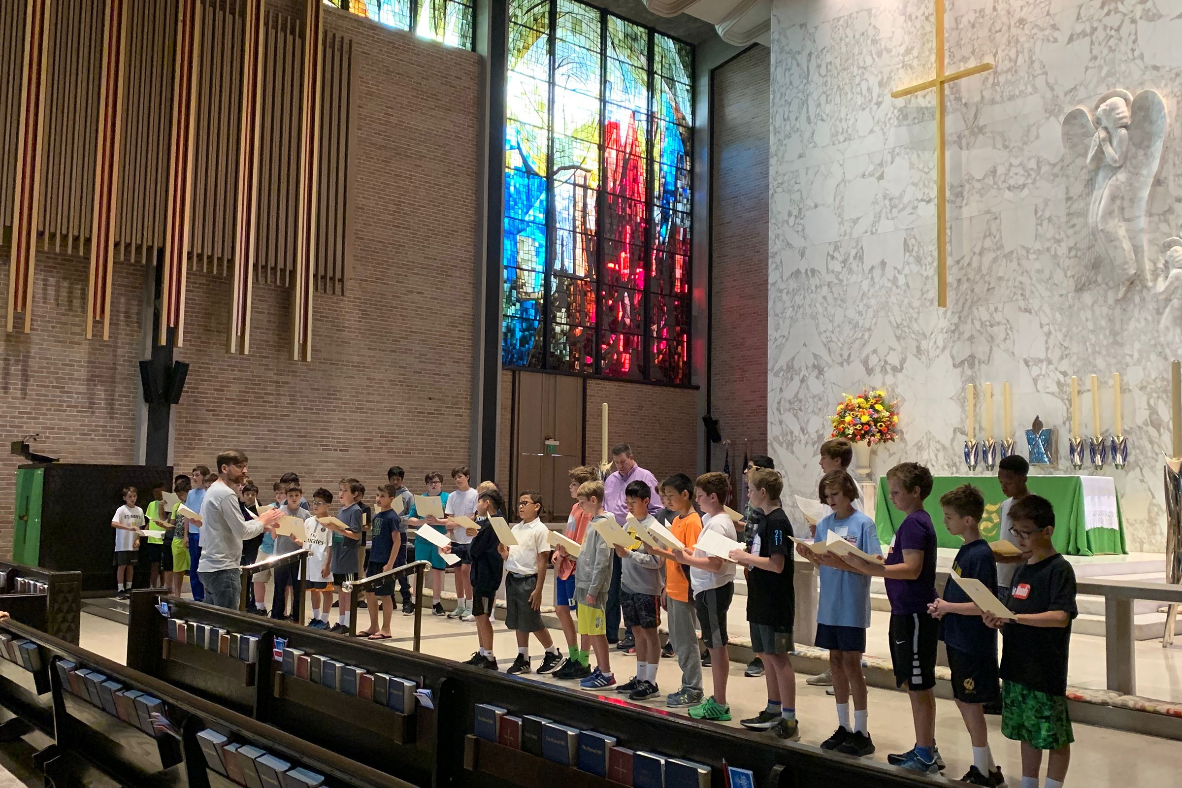 The Middle School Choir rehearses at Saint Michael and All Angels Episcopal Church in preparation for November
