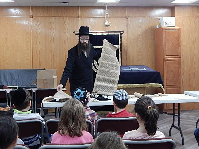 A sofer visits the 2nd Grade to get the ready to receive their Chumashim.