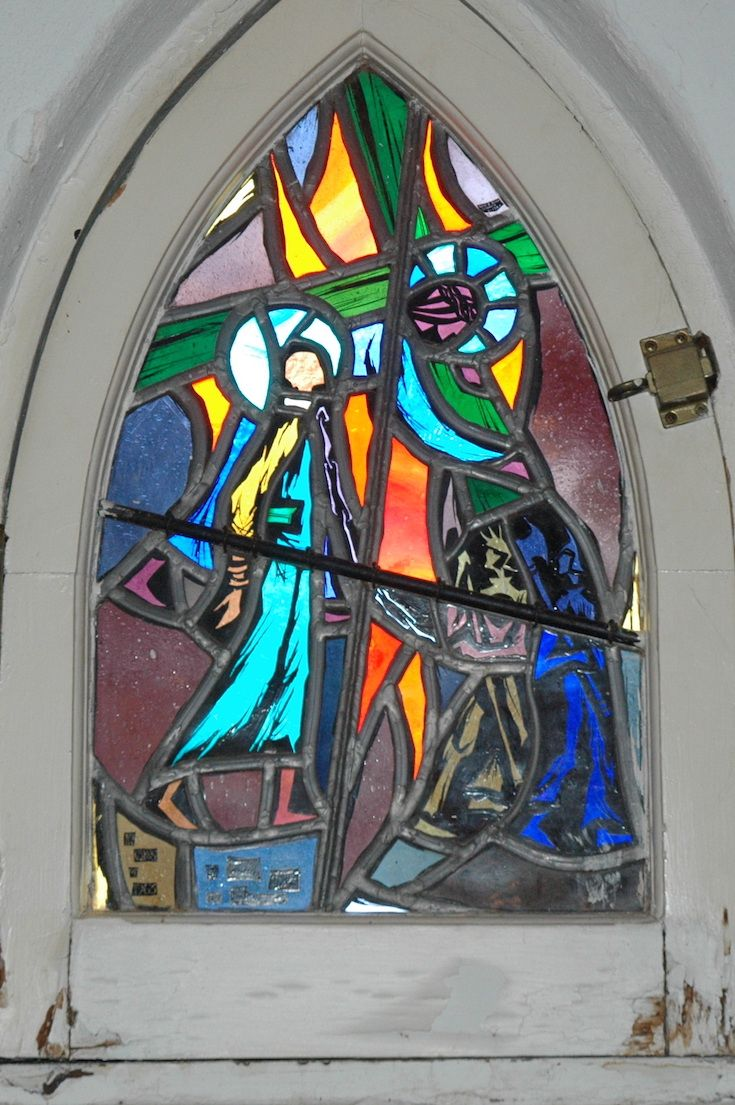 In this Tolkien-inspired stained-glass window of St. Alban, two Orcs (malicious minions of the Lord of the Rings' Sauron) deliver the first British martyr in chains to his executor.