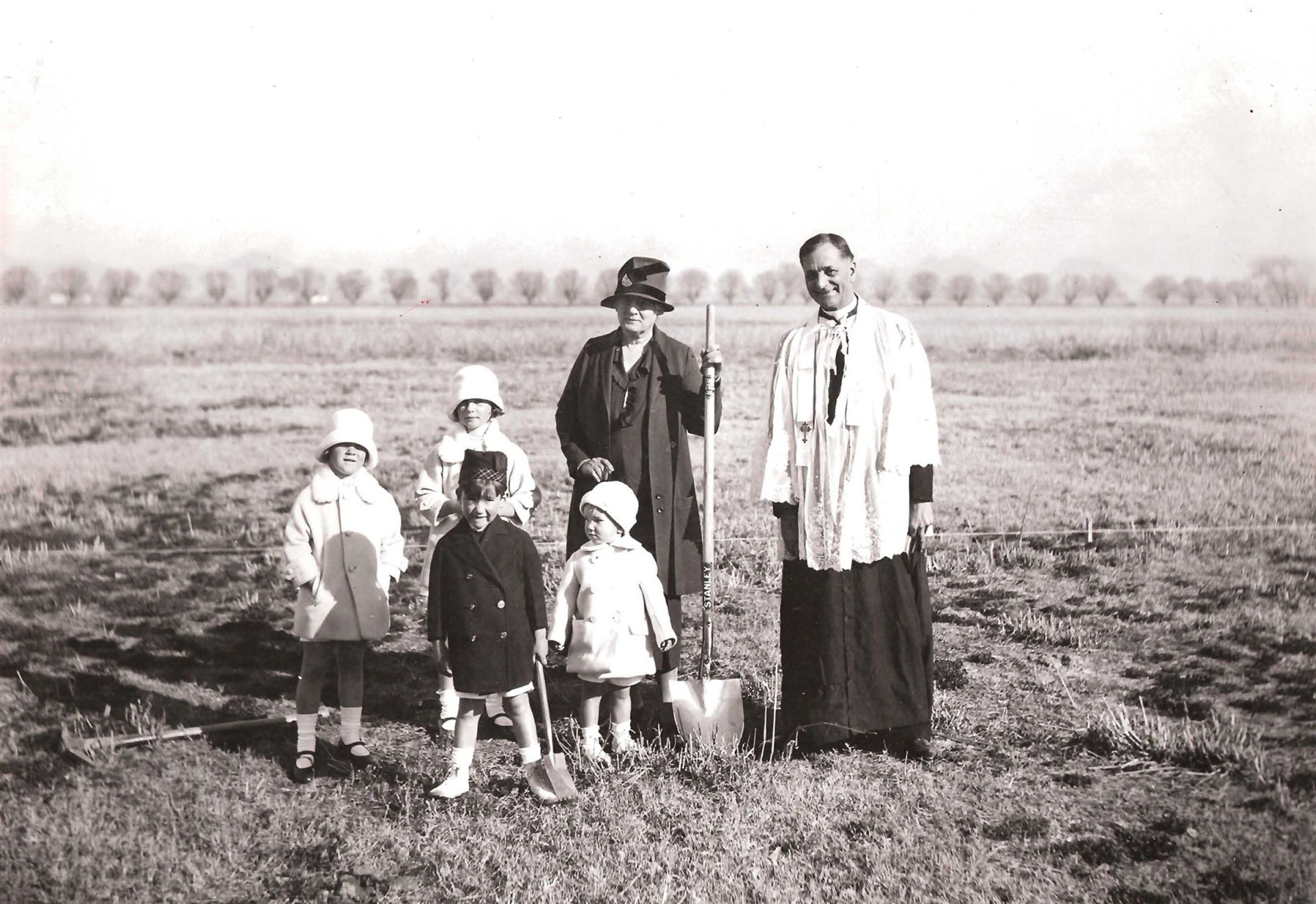 Foundress Mrs. William Henry Brophy and family with Father Felix Rossetti, S.J.