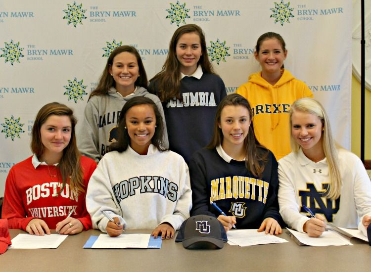 Members of the Class of 2017 sign their commitment letters to play a collegiate sport