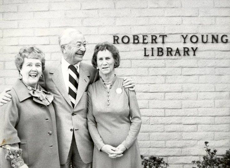 The Youngs and Dr. Buckley in front of the original Robert Young Library.