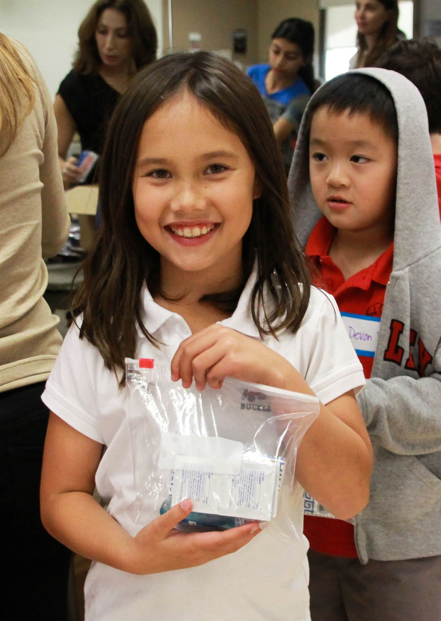 Lower School students prepare toiletry bags for Gobble Gobble Give.
