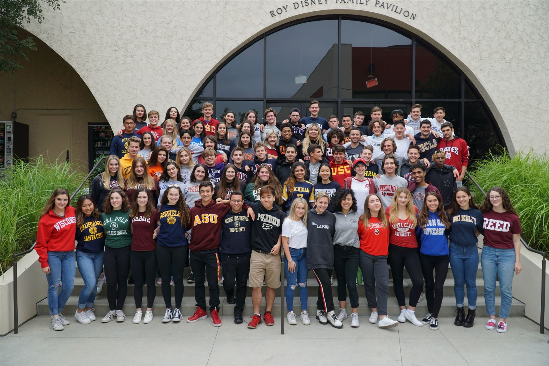 The Class of 2018 in their college T-shirts