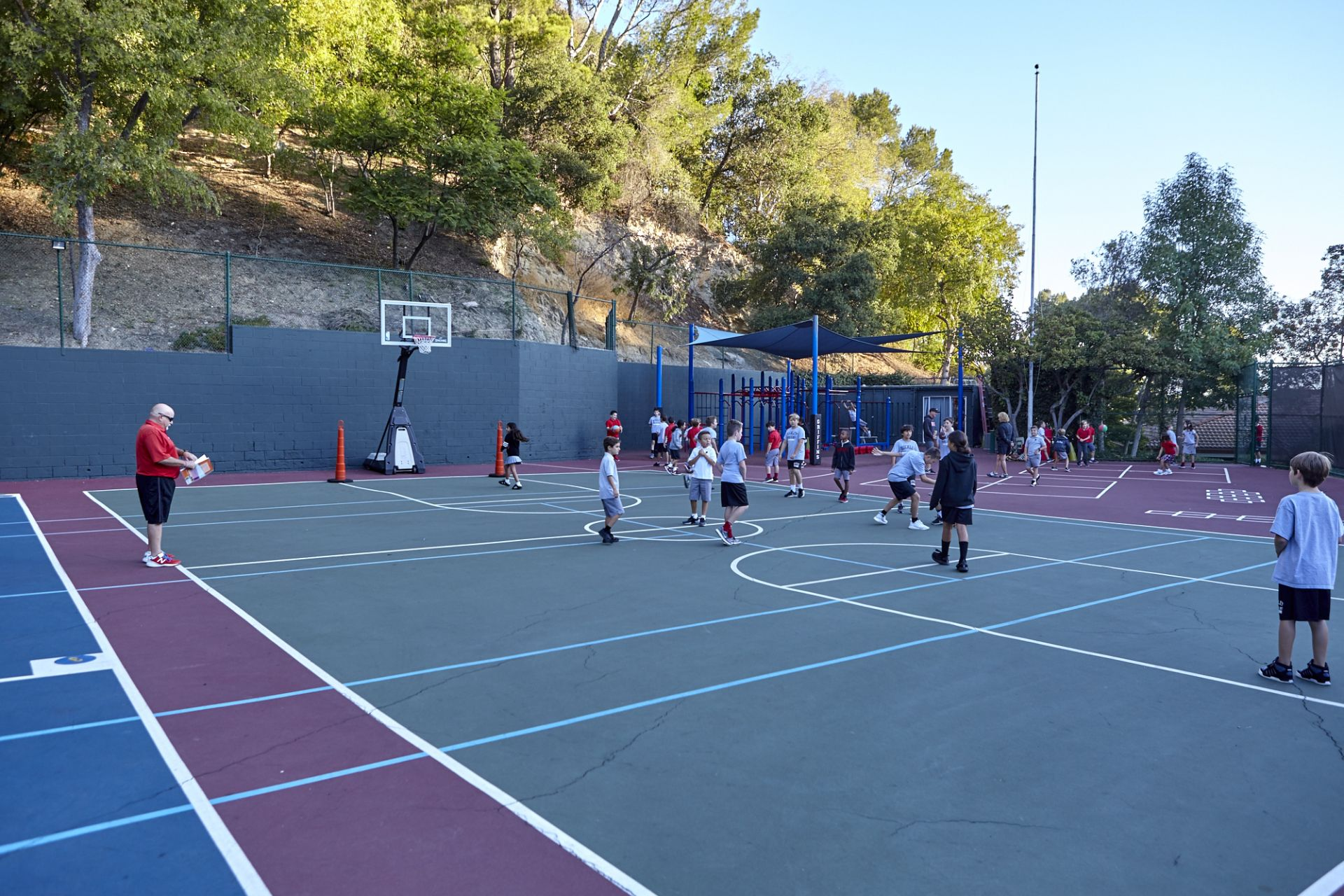 Physical education classes for third through fifth grade are held on the elementary play yard.