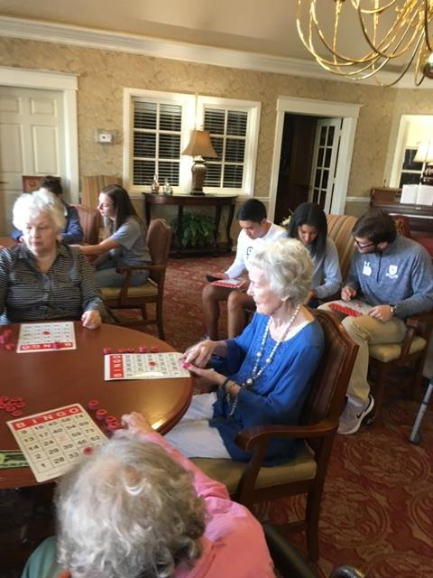 Casady students visit Brookdale Assisted Living during  Upper Division service project day. The Senior Class enjoyed playing Bingo with the enthusiastic elderly residents.