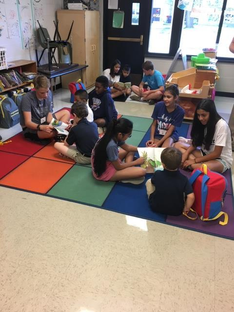 Middle Division Service Club members mentor the youngest Jaguars at Andrew Johnson Elementary School in The Village. Casady students packed much needed supplies. The backpacks were then donated to the Pre-K reading buddies.