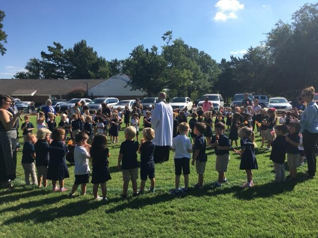 Father Youmans speaks about peace and the wind of the Holy Spirit. The youngest Cyclones enjoy seeing the pinwheels spin their vibrant colors on International Day of Peace 2018.