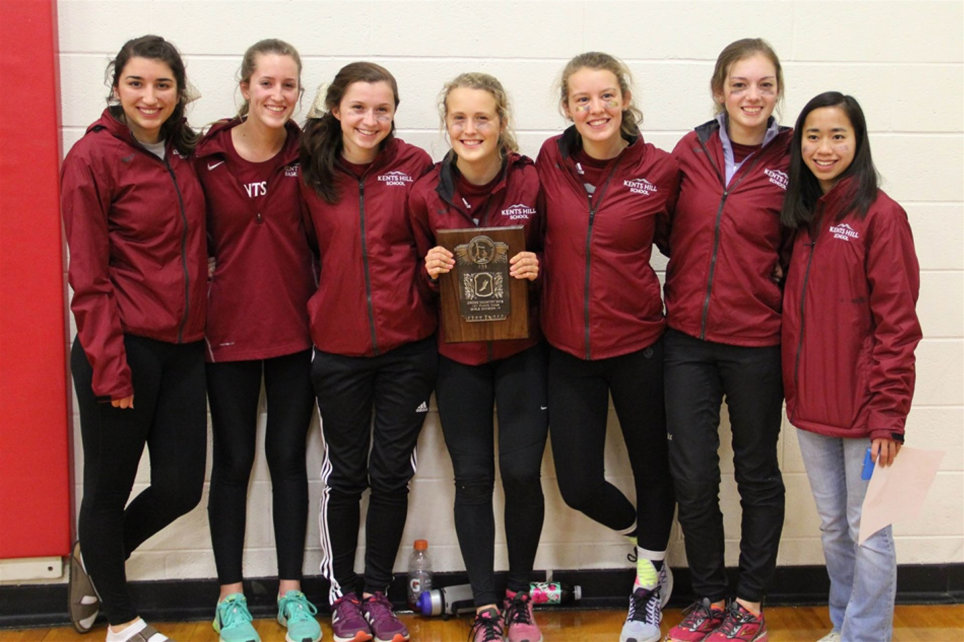 The 2015 Girls Varsity Cross Country team after winning their second consecutive title.
