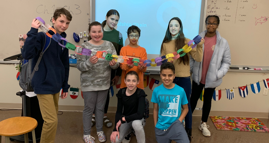 Middle School students create a friendship chain during their March Diversity Club meeting.