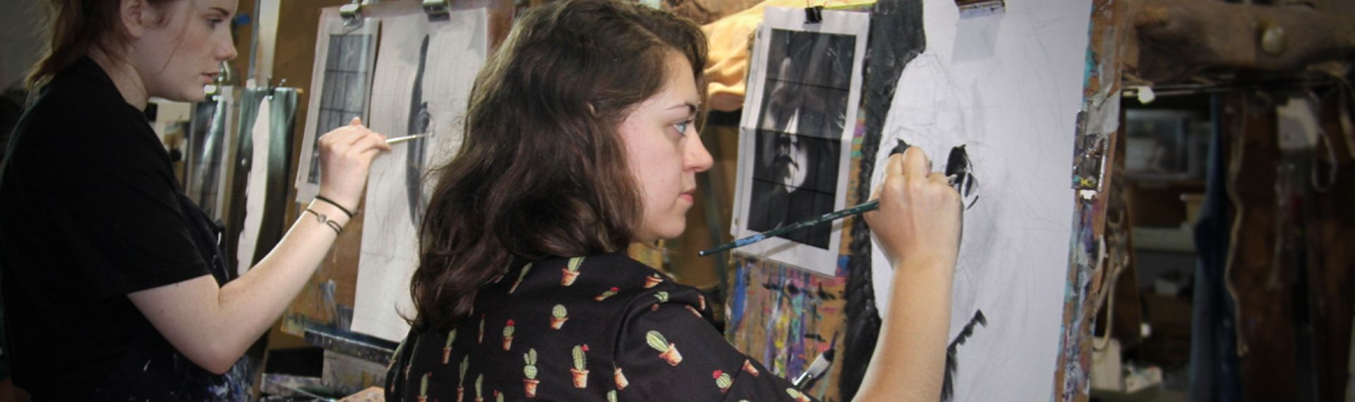 Upper School students paint portraits.