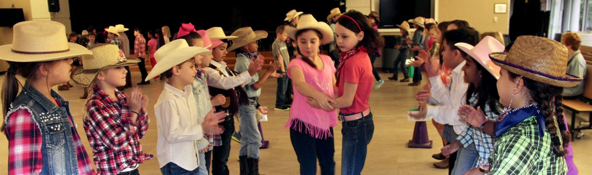 2nd Grade students dancing at a hoe down.