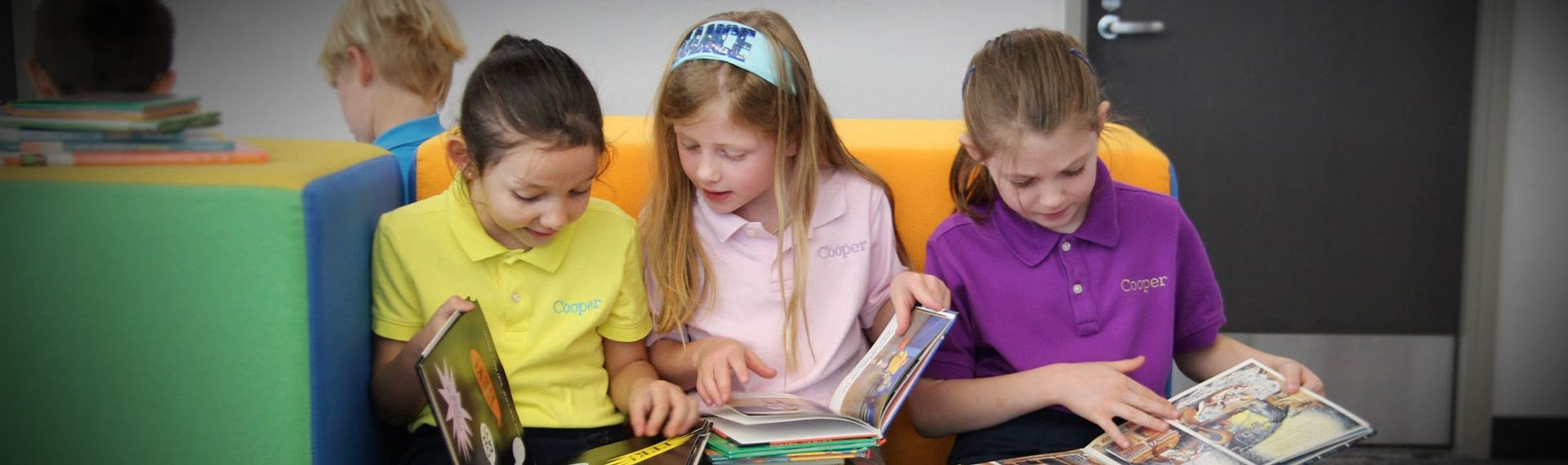 Students read in hte Lower School library.