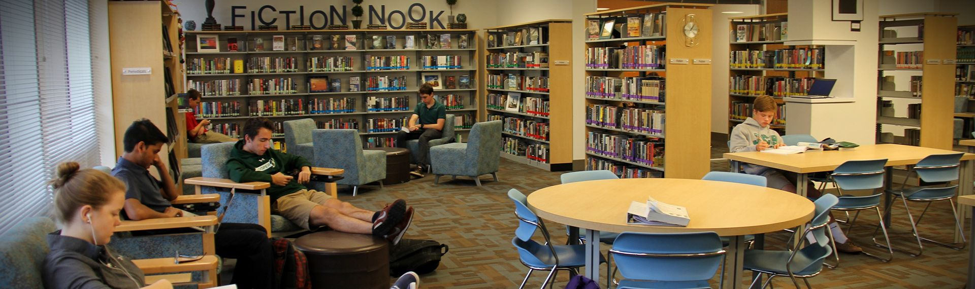 students study in the Upper School library.