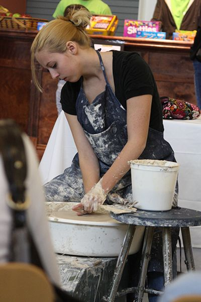 Student creates clay pot at Fine Arts Festival.