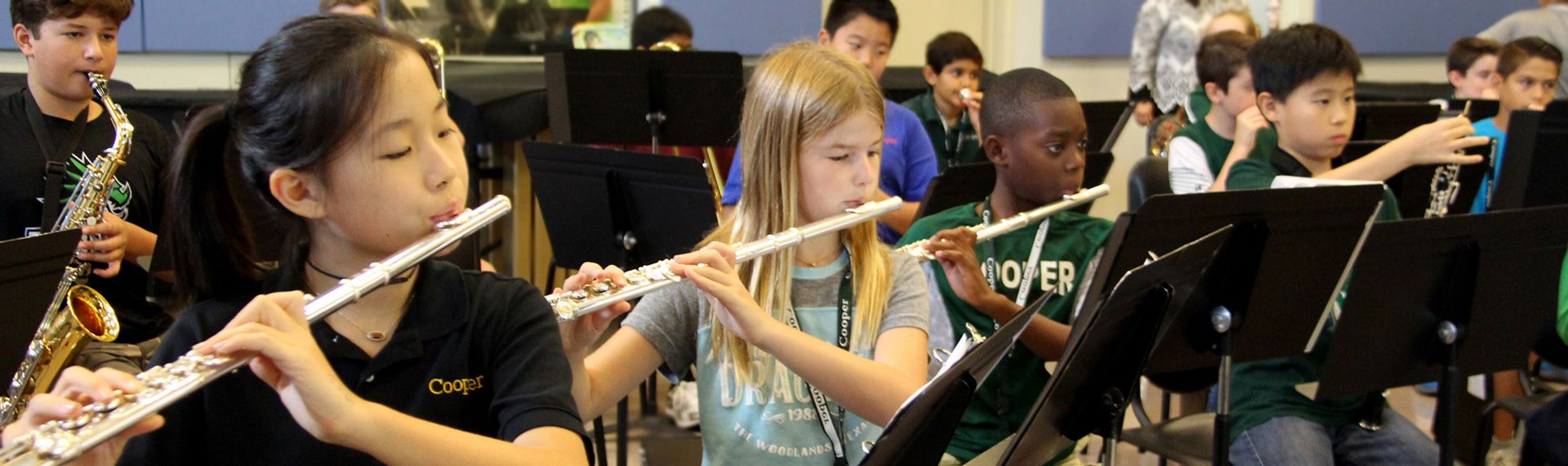 Middle School band students practice their instruments.