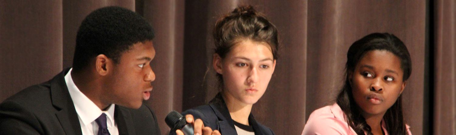 Upper School students participate in debate.