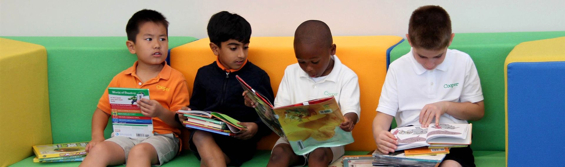 Lower School students read at the library.