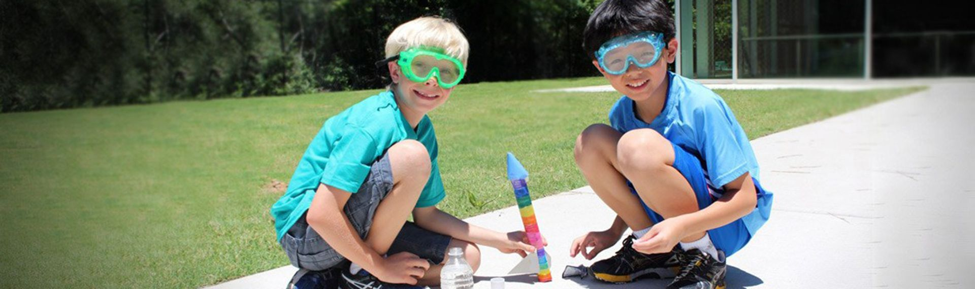 Two Lower School students build a rocket.