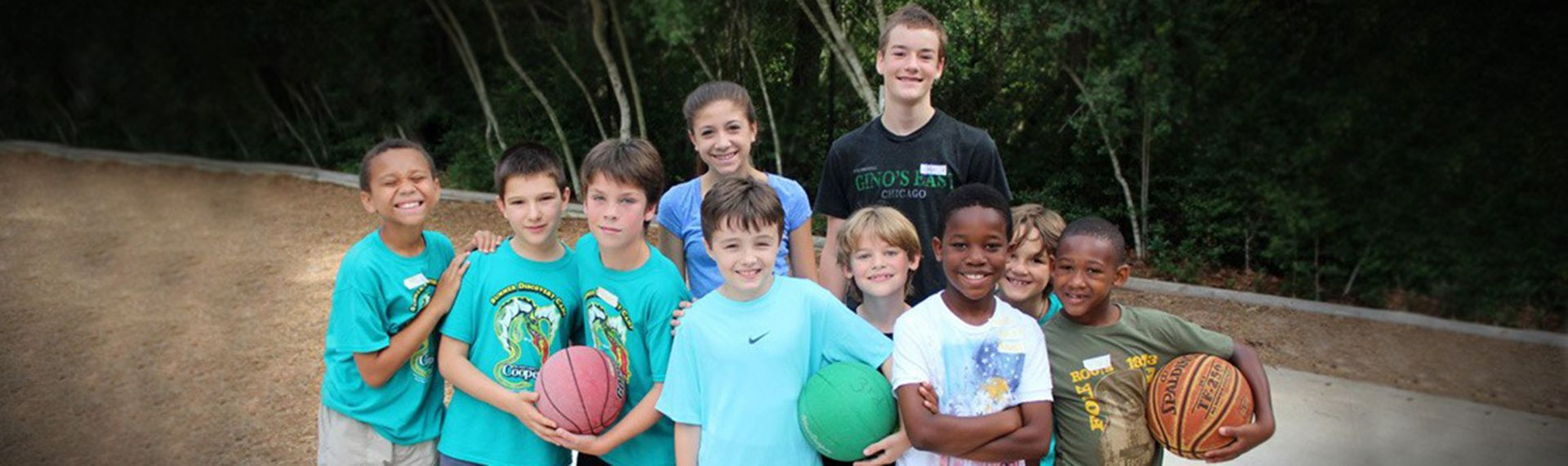 Lower School students pose during playground basketball game.