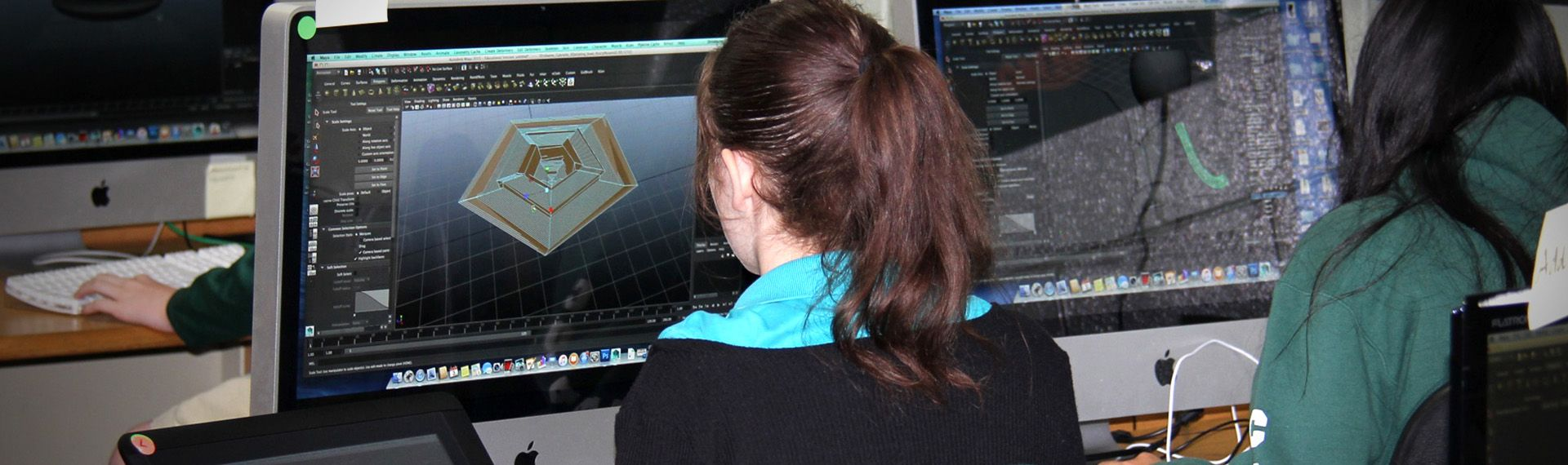 Students create 3D animation on computers.