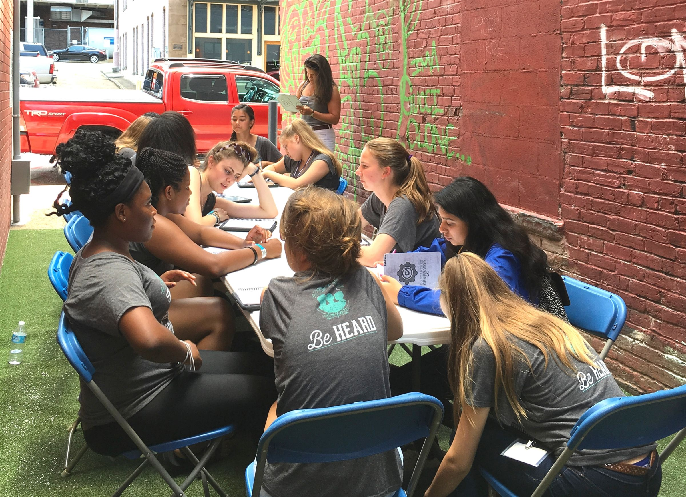 Girls working on project in designed alleyway in Chattanooga